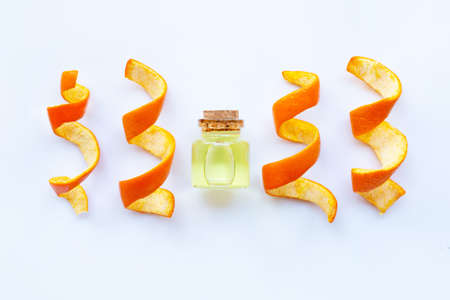 Essential oil of orange on white background.