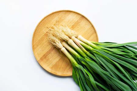 Young green garlic on white background 版權商用圖片