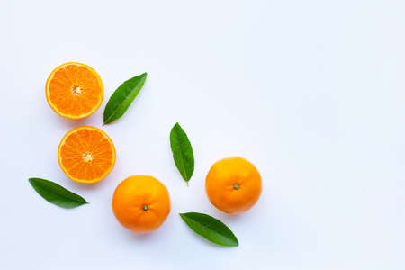High vitamin C,  Fresh orange citrus fruit with green leaves on white background. Copy space 版權商用圖片