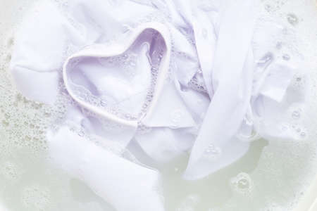 Soak a cloth before washing, white shirt