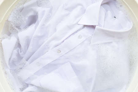 Soak a cloth before washing, white shirt