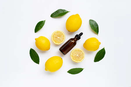 Fresh lemon with lemon essential oil on a white background. Stock Photo