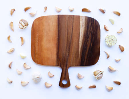Garlic with wooden cutting board on white background
