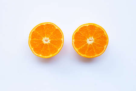 Fresh orange citrus fruit on white background.
