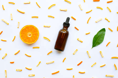 Essential oils with citrus fruits on white background.