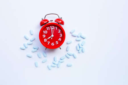 Red alarm clock ring with PrEP ( Pre-Exposure Prophylaxis). used to prevent HIV. Stock Photo