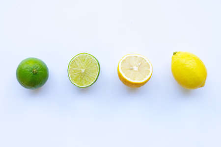 Ripe lemons and limes on white background.