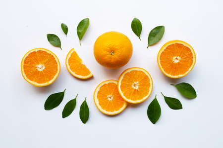 Fresh orange citrus fruit with leaves isolated on white background. Juicy, sweet and high vitamin C