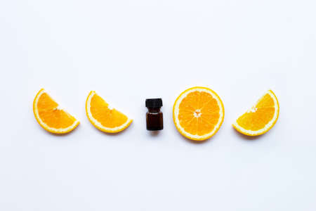 High vitamin C, Orange fruits with essential oil bottle on white background
