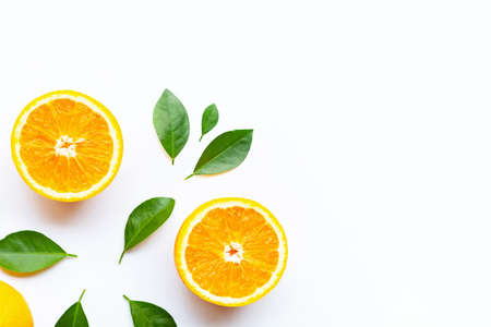 Fresh orange citrus fruits with leaves on white background.  Copy space