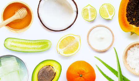 Natural ingredients for homemade skin care on white background.