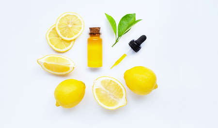 Essential oil with lemon on white background. Stock Photo