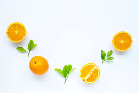 High vitamin C, Juicy and sweet. Fresh orange fruit with green leaves on white background. Copy space Archivio Fotografico