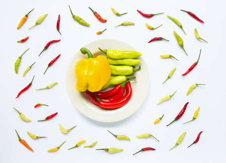 Bell pepper and chili peppers isolated on white background