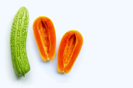 Bitter melon with papaya on white background. Sex concept, Copy space