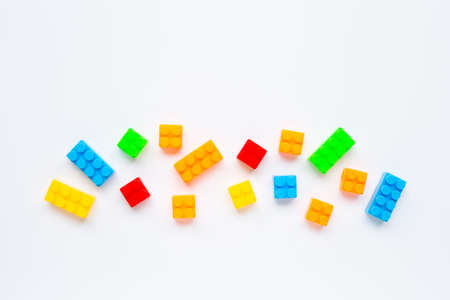 Plastic building blocks isolated on white background. Top view