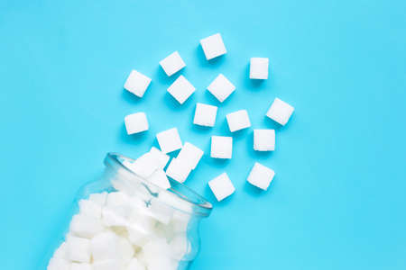 Cubes of sugar on a blue background. Top view