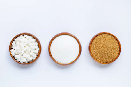 Wooden bowl with sugar on white background. Top view