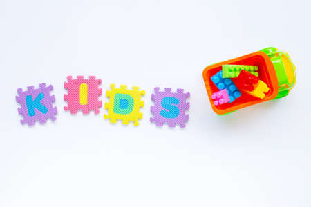 Colorful Kids toys with alphabet KIDS Puzzle Pieces  on white background. Imagens