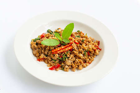 Stir-fried hot and spicy pork with basil on white background. 스톡 콘텐츠