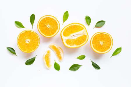 High vitamin C. Fresh orange citrus fruit with leaves isolated on white background.
