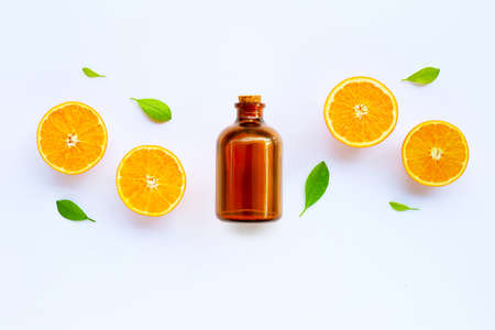 High vitamin C. Fresh orange citrus fruit with essential oil isolated on white background.