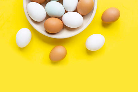 Eggs on yellow background. Top view