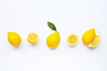 Fresh lemon with leaves isolated on white background.