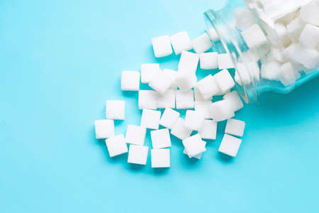 Cubes of sugar on a blue background. Copy space Banco de Imagens