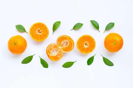 Fresh orange citrus fruit with leaves isolated on white background