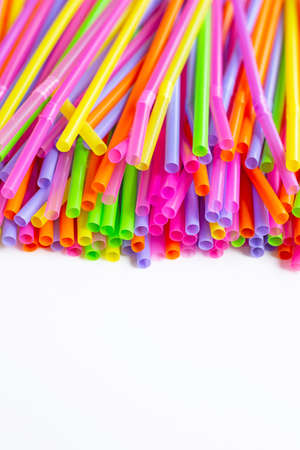 Colorful plastic  straws on white background. Plastic waste pollution.