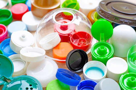 Colorful plastic bottle caps and plastic glass lid Stock Photo