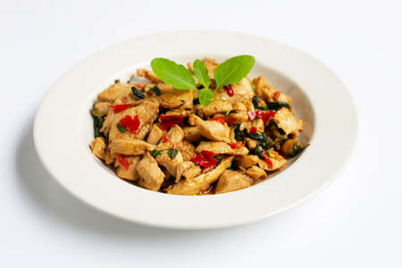 Stir-fried chicken with holy basil on white background.