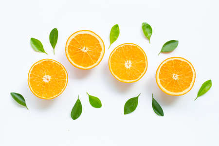 High vitamin C. Fresh orange citrus fruit with leaves isolated on white background.
