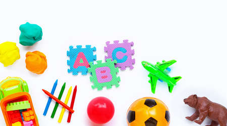Colorful kids toys on white background. Copy space