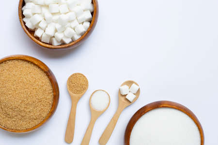 Various types of sugar on white background. Copy space