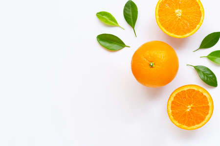 Fresh orange citrus fruit with leaves isolated on white background. Juicy and sweet. Copy space