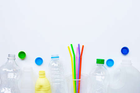 Plastic waste on white background. Copy space