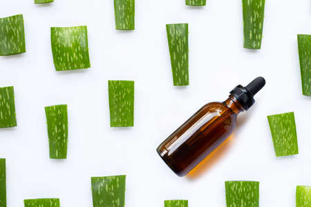 Essential oil with Aloe Vera cut pieces on white background.