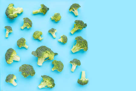 Fresh green broccoli on blue background. Copy space 写真素材