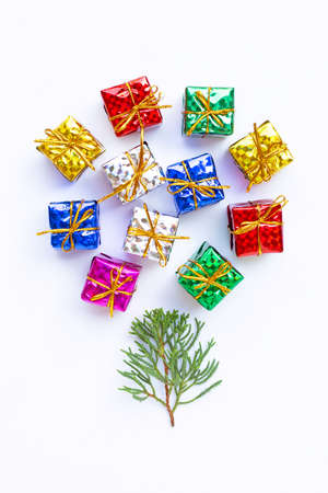 Merry Christmas and Happy Holidays, Christmas composition. gifts, pine branches on white background.