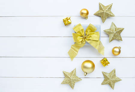 Merry Christmas and Happy Holidays, Christmas composition. gift box and decorations on white wooden background. Top view 写真素材