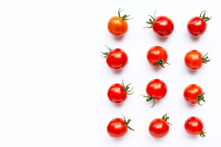 Fresh cherry tomatoes on white background. Copy space