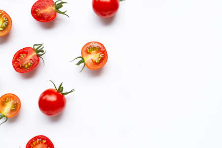 Fresh tomatoes, whole and half cut isolated on white background. Top view Banco de Imagens