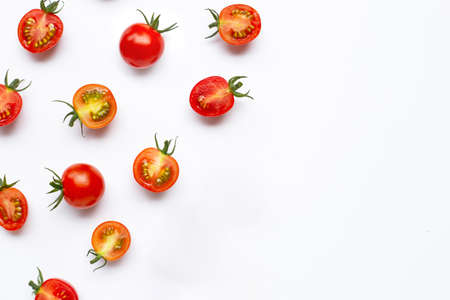 Fresh tomatoes, whole and half cut isolated on white background. Top view 写真素材
