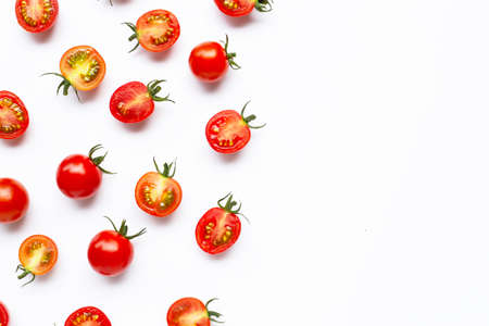 Fresh cherry tomatoes, whole and half cut isolated on white background. Copy space Banco de Imagens