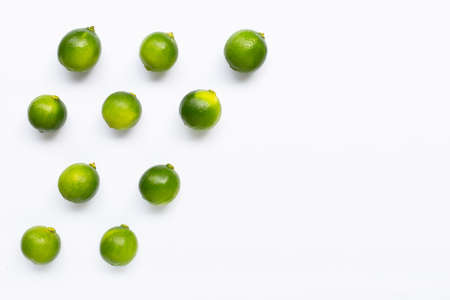 Limes isolated on white background. Top view