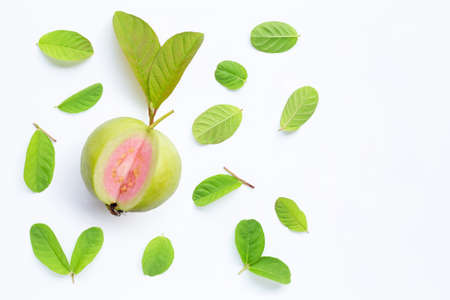 Top view of fresh ripe guava and slices with leaves on white background. Copy space
