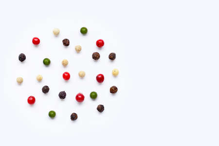 Red, green, white and black peppercorns on white background.. copy space 写真素材
