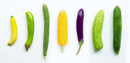 Banana, eggplant, corn, luffa acutangula, bitter melon,  green papaya on white background.